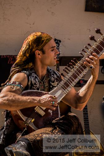 Man playing citar - RenFaire2010-0073